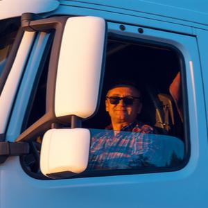 Trucker in cab being reimbursed using TruckLogics' invoicing software solution.