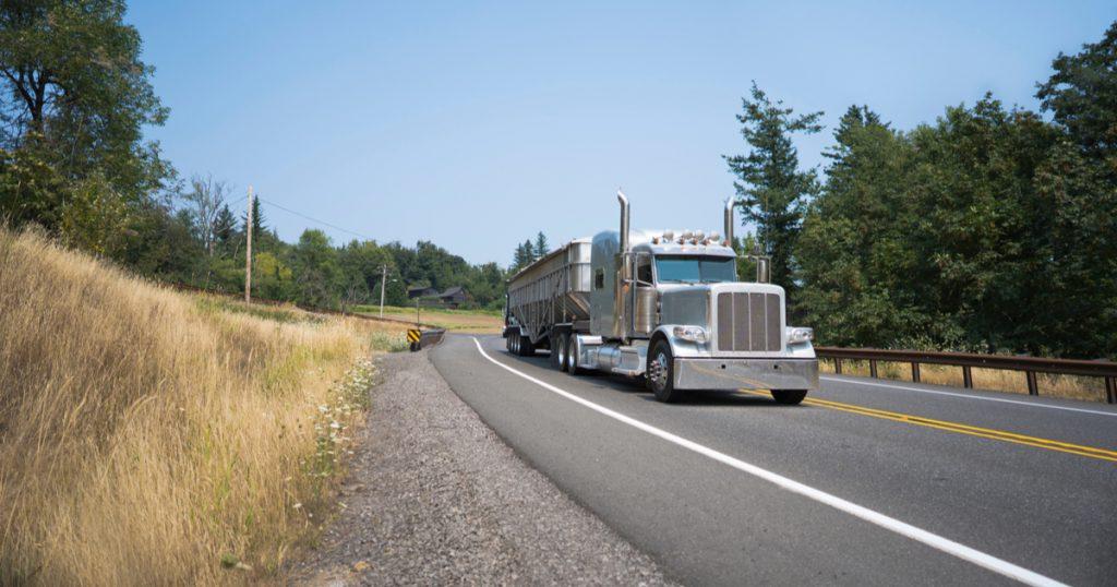 Trucker driving on interstate using TruckLogics trucking dispatch software.