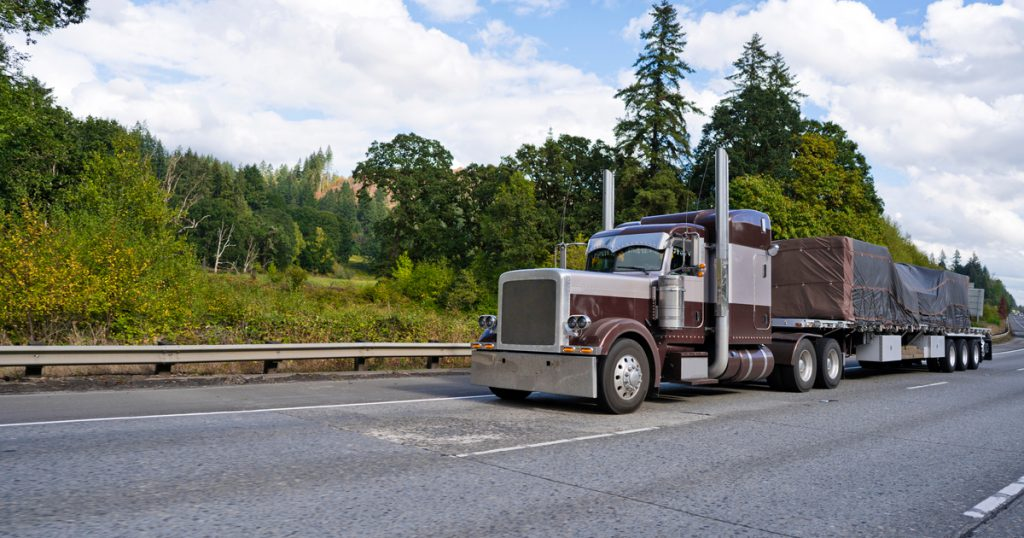 Trucker using new TruckLogics trucking management system features