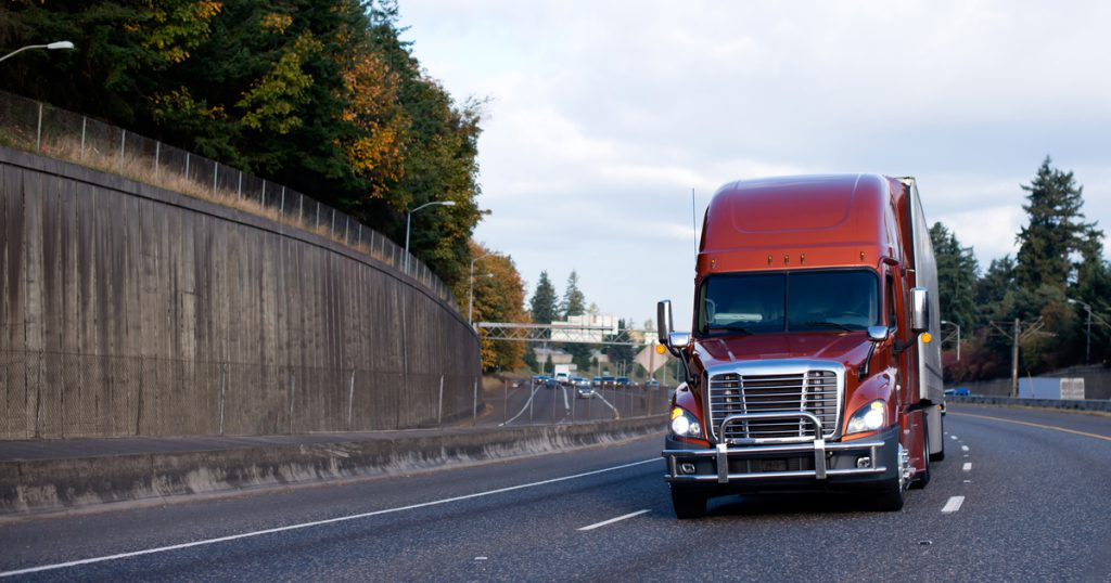 orange truck on interstate managing truck maintenance expenses