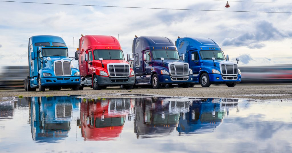 Company fleet drivers parked using TruckLogics trucking management software mobile app